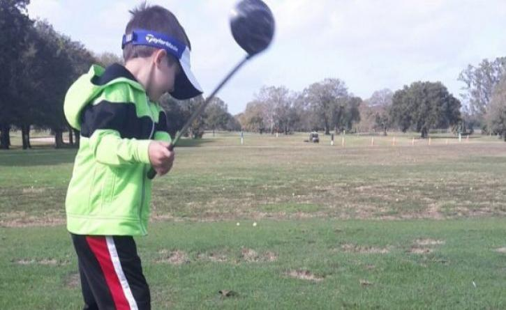 Autistic boy 'swings' to life thanks to golf